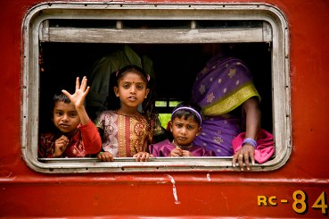 Local children riding the rails - Elephants, beaches and temples of Sri Lanka
