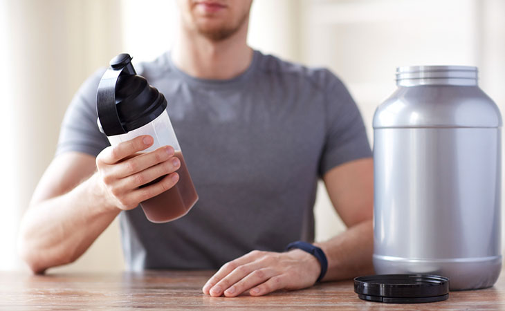 Man Drinking At Blender Bottle
