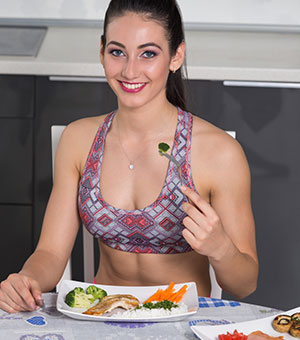 Fit Woman Eating Healthy Protein Food