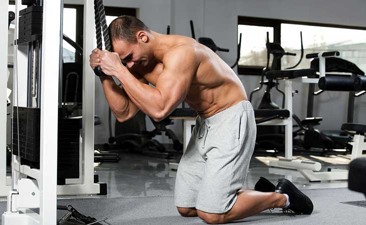 Man Doing The Cable Crunch Workout For Abs