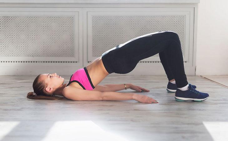 Woman Doing Bridge Exercise To Lose Post Partum Tummy
