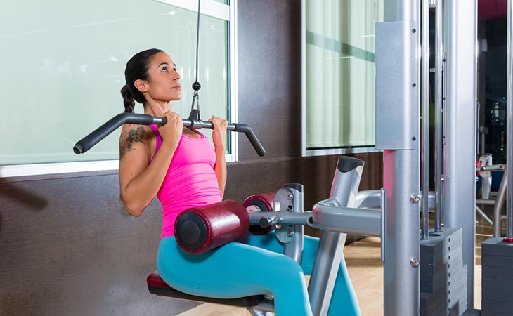 Woman Working Out Reverse Grip Pulldown