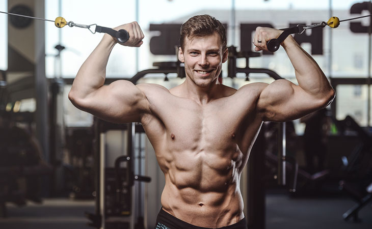Man Working Out Traditional Cable Crossover