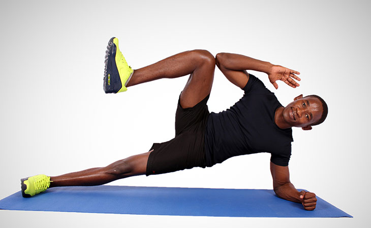 Man Showing How To Side Plank Crunches