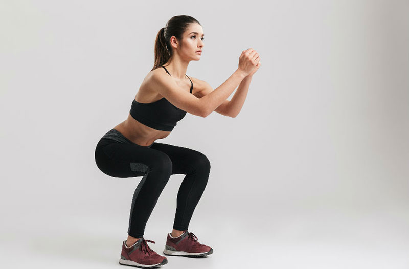 Woman Showing How To Squat Pulses