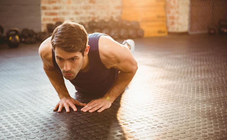 Man Working Out Triangular Push Ups