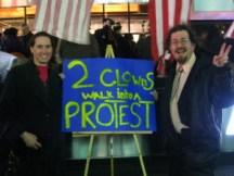The authors with an Occupy Broadway protest sign