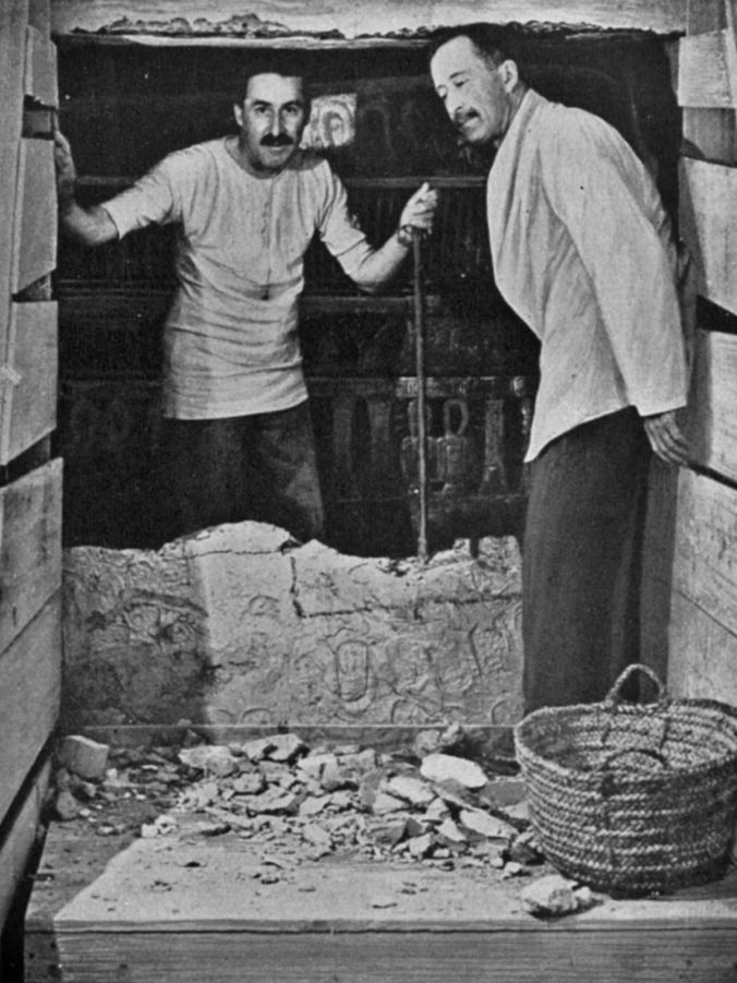 Howard Carter (left) and Lord Carnarvon breaking into Pharaoh Tutankhamun tomb in Egypt's Valley of the Kings.
