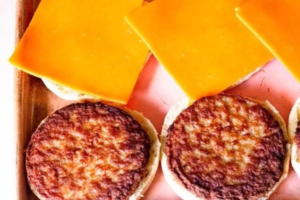 sausage and cheese on an engli