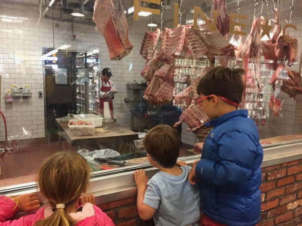 Amelia, Theo, and Luka looking at the meat at the Park Slope Whole Foods
