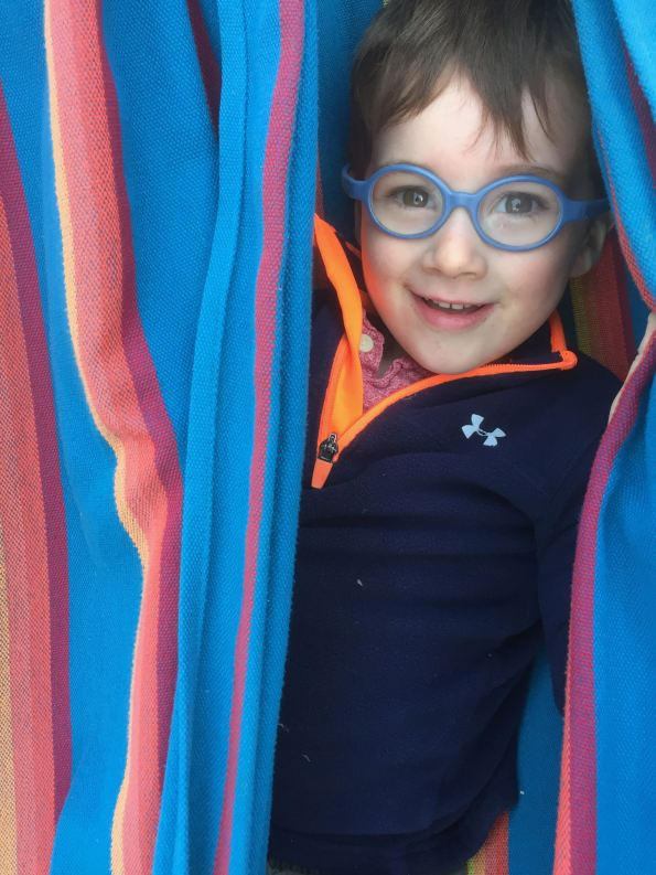 Theo in a hammock at Lodge Hill