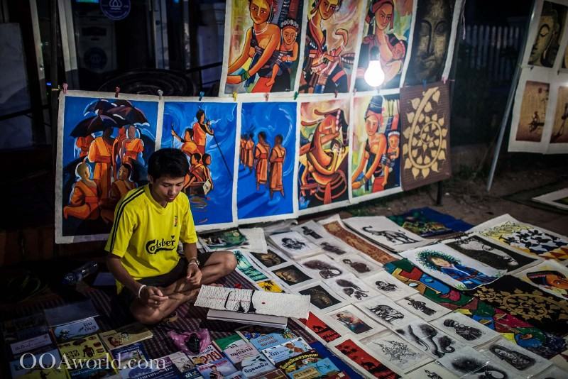Boy Selling Art at Luang Prabang Market Photo Ooaworld
