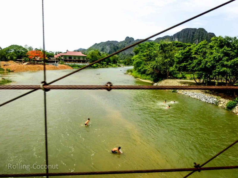 Children Playing in the River in Vang Vieng Laos Rolling Coconut Ooaworld Photo Ooaworld