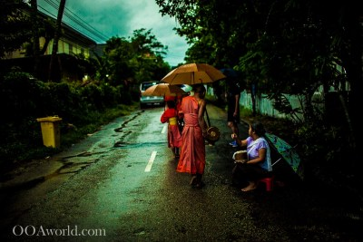 Feeding Monks Laos Video Alms Giving Tak Bat Monk Walk Luang Prabang Photo Ooaworld