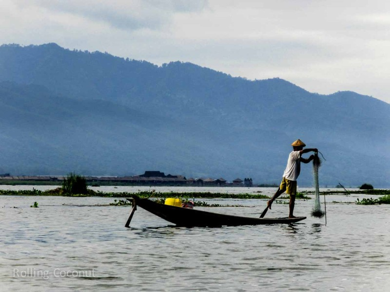 Myanmar Itinerary Inle Lake Fisherman With Net Rolling Coconut Ooaworld Photo Ooaworld