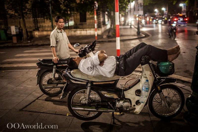 Hanoi Street Photography Sleeping on Moped Vietnam Photo Ooaworld
