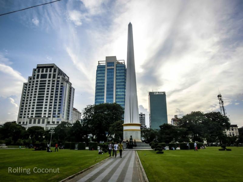 National Independence Monument Yangon Myanmar ooaworld Rolling Coconut Photo Ooaworld