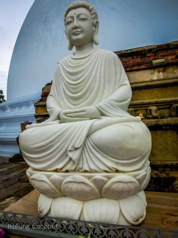Buddha Statue anuradhapura Sri Lanka ooaworld Rolling Coconut Photo Ooaworld
