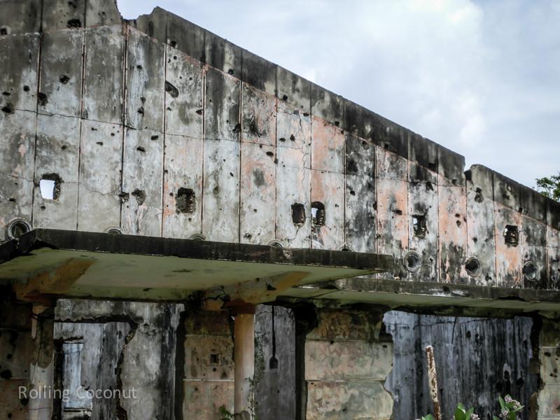 Bullets on the Wall Jaffna Sri Lanka ooaworld Rolling Coconut Photo Ooaworld