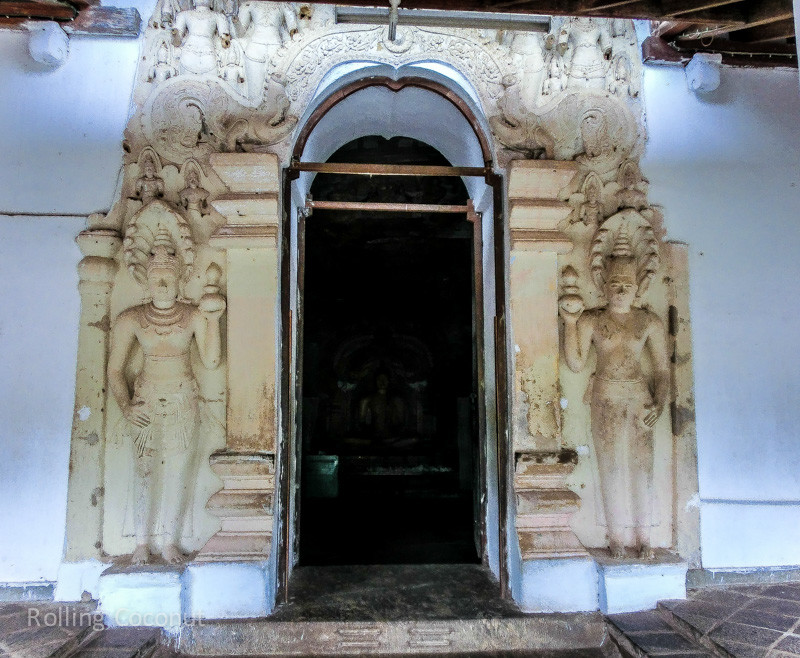 Carvings Door Golden Temple Cave Dambulla Sri Lanka ooaworld Rolling Coconut Photo Ooaworld