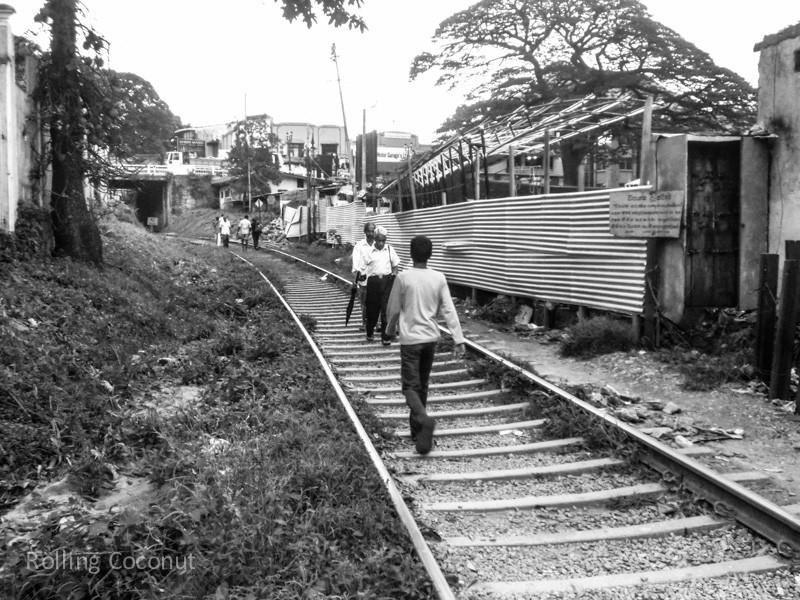 Kandy Rainlway Tracks Walking Commute Sri Lanka ooaworld Rolling Coconut Photo Ooaworld