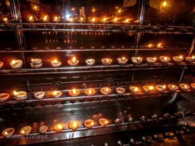 Kandy Temple Tooth Candles Prayers Sri Lanka ooaworld Rolling Coconut Photo Ooaworld
