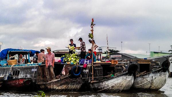 cai rang boats vietnam photo ooaworld Rolling Coconut