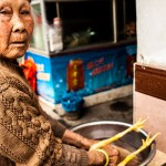 Portrait of a Chinese woman about to boil a chicken