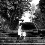 Mother and Child Looking back and up to the temple, Kyoto Japan