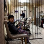 Child waiting at Kyoto barber shop Japan