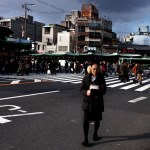 Kyoto street scene crosswalk woman Japan