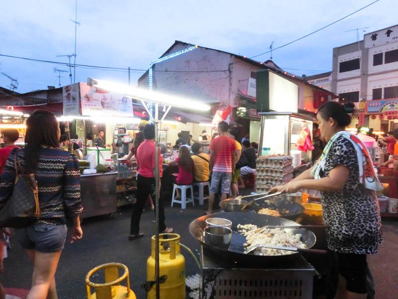 Cooking Melaka Night Market Malaysia photo ooaworld Rolling Coconut