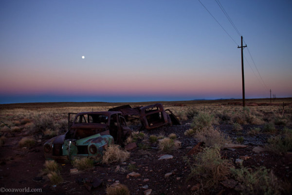 Car wreck near Meteor Crater at sunset, Arizona