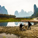 A painter sets up in front of Yangshuo's karst mountains
