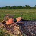 tricking - man laying in a ground blind