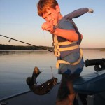 Fishing for bass on Lake Restoule near Horseshoe Island. Ryan, 7, is an excellent caster and loves to fish!