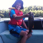 Jaiden Johnson, 10, fishing with dad Matthew on a beautiful day just outside Huntsville on Harp Lake. Lots of fish caught for catch and release.