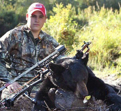 perfect match - Chris Perkins with a bear