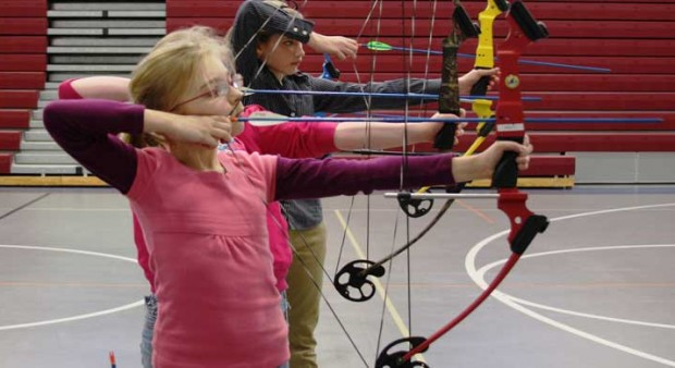 kids shooting bows