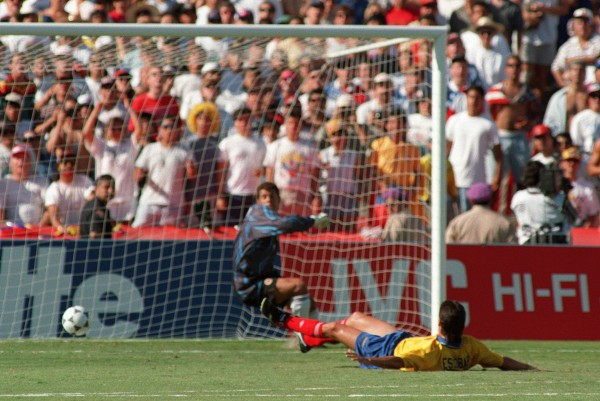 Colombian defender Andres Escobar lies on the grou