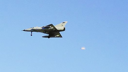 AAF Mirage M3 fighter and UFO taken during maneuvers of the IV Aerial Brigade in Mendoza on November 18, 2005. (Image credit: Visión Ovni)
