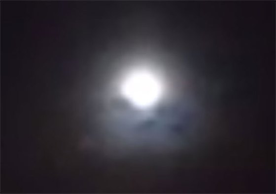 Cropped and enlarged still frame from witness video. At one point in the video, the group wonders what the black blotches are below the moon. (Credit: MUFON)
