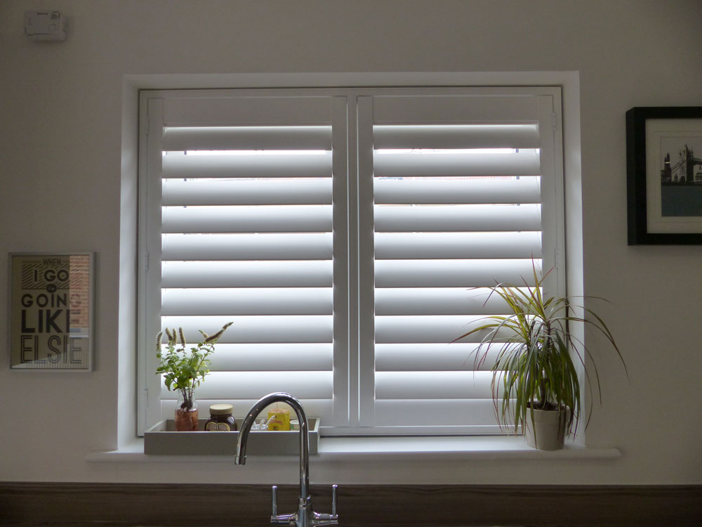 kitchen window shutters antiquing cabinets opennshut expert shutter suppliers for diy trade white tpost fitted to above the sink