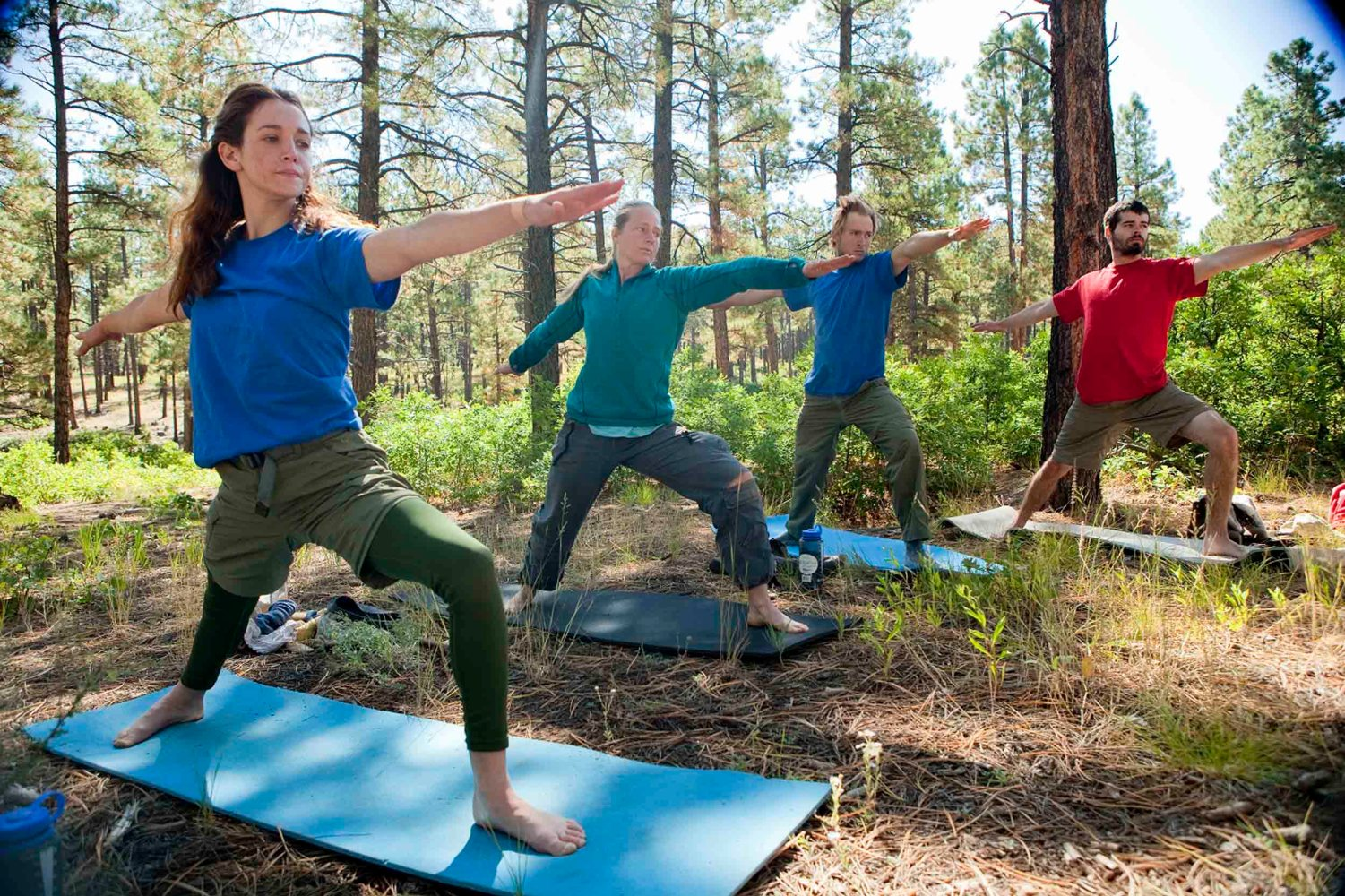 Students and staff at Open Sky Wilderness do yoga in Colorado