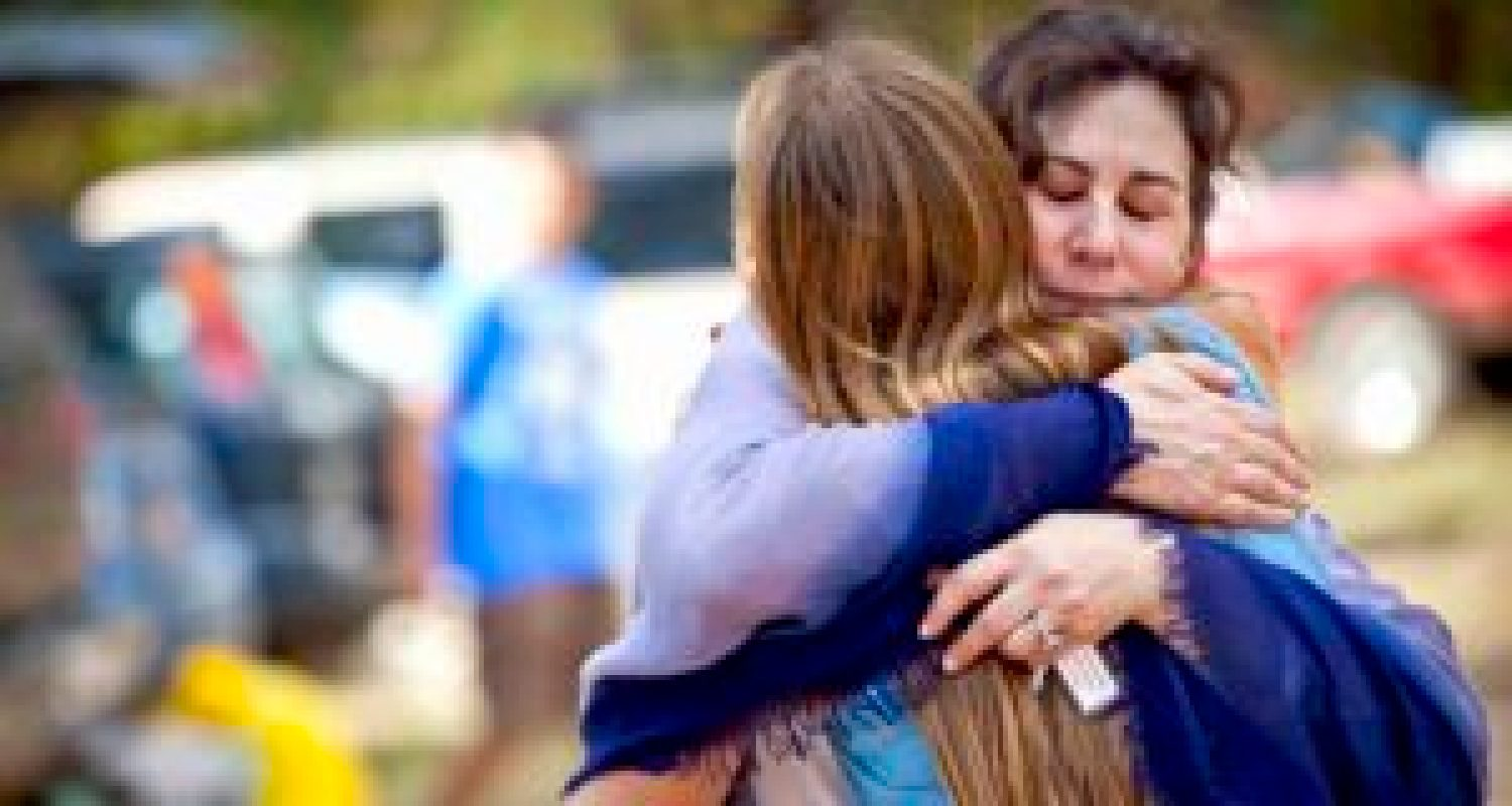 Mother and Daughter Hug at Open Sky Wilderness Therapy