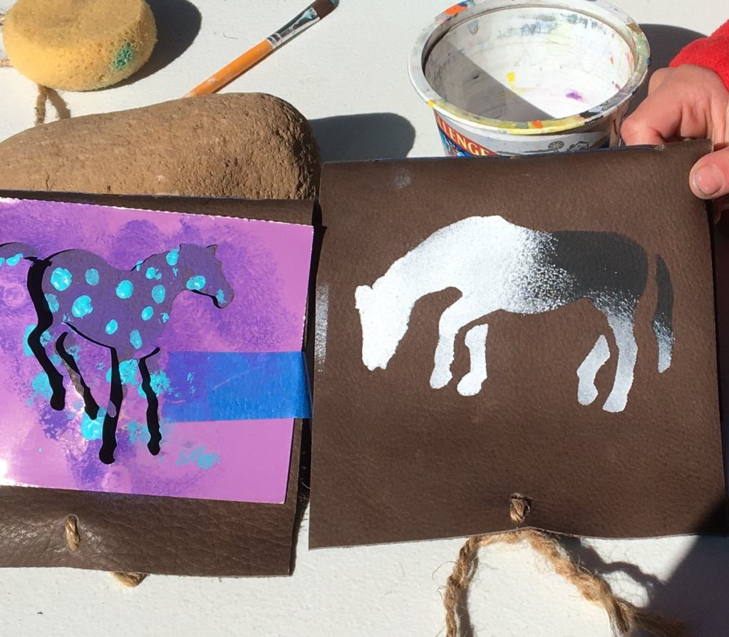 Colorful artwork made by Open Sky Wilderness Therapy pre-teen studesnts at Medicine Horse Center.