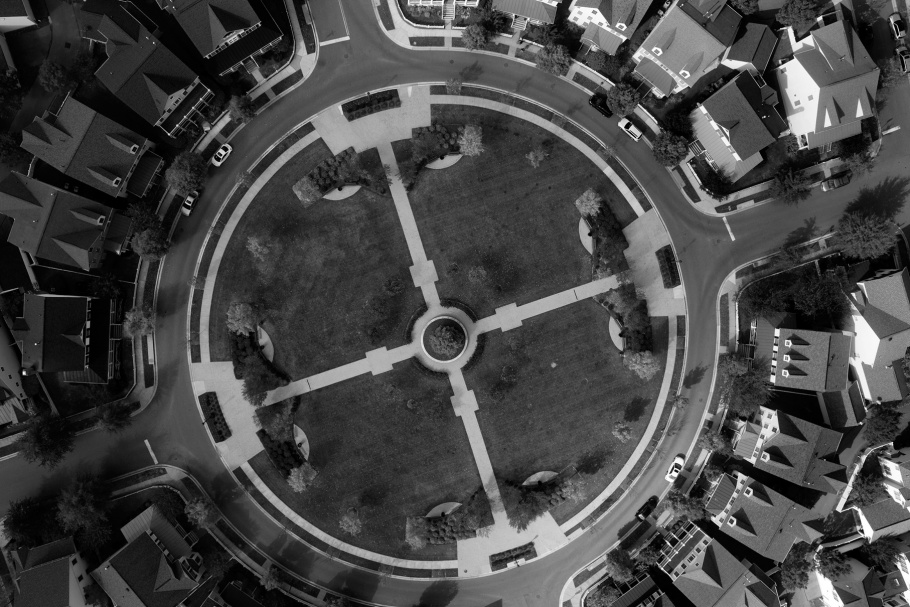 Aerial photograph of residential subdivision with circular park at center
