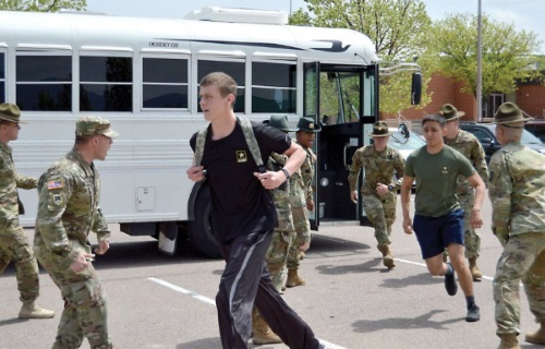 army recruits getting off bus and yelled at by drill instructors