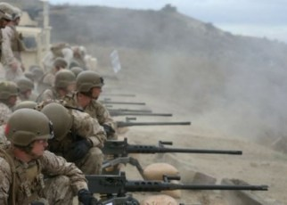 marine infantryman training on 50 caliber machine guns