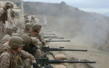 marine infantryman training on 50 caliber machine guns